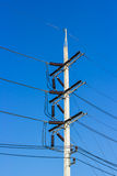 Electrical post with power cable Royalty Free Stock Images