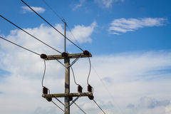 Electrical post by the road with power line cables Stock Photography