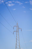 Electrical post by the road with power line cables, Royalty Free Stock Photography