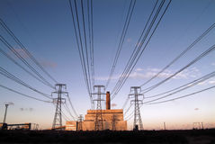 Electrical power. Powerstation with pylons and cables royalty free stock photos