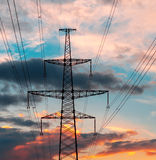 Electrical power line against cloud and blue sky.  Royalty Free Stock Photo