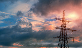Electrical power line against cloud and blue sky.  Stock Images