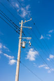Electrical power line cables and concrete pole with transformer royalty free stock photography