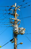 Electrical power line cables and transformers in Japan Stock Photo
