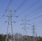 Electrical power lines. On blue sky background Stock Photography