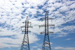 Electrical power lines. Mast electrical power line on a sunny day Royalty Free Stock Image