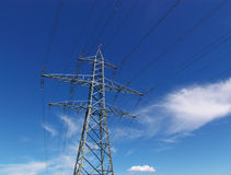Electrical power lines. Overhead electrical power lines or cables with blue sky and cloudscape background Stock Photography