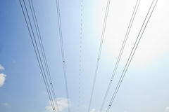 Electrical Power lines against clear Skype Stock Photos