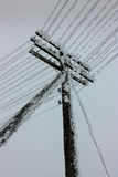 Electrical power lines with hoarfrost on the wooden electric pole on countryside in the winter Royalty Free Stock Images