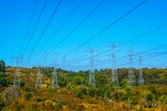 Electrical power lines over the hills royalty free stock images