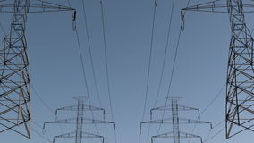 Electrical power lines and pylons under sky. energy conservation conception. Pan of electrical power lines and pylons under sky. energy conservation conception stock video