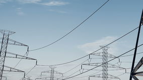 Electrical power lines and pylons under sky. energy conservation conception. Pan of electrical power lines and pylons under sky. energy conservation conception stock footage