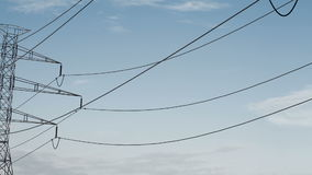 Electrical power lines and pylons under sky. energy conservation conception stock footage
