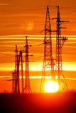 Transmission towers with sunset Stock Images