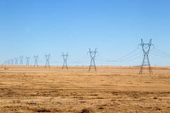 Free Electrical Power Lines Under A Blue Sky Royalty Free Stock Photo - 85573675