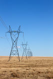 Electrical Power Lines under a blue sky Stock Images
