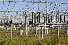 Electrical power plant in farmland area Stock Photos