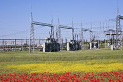 Electrical Power Plant In Colorful Meadow Royalty Free Stock Photography