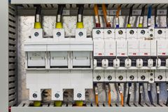 Electrical power devices. Electrical power protection devices fuses and circuit breakers installed in control cubicle, three phase and single phase power supply royalty free stock photos