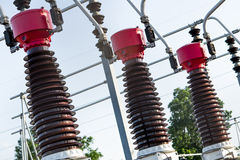Electrical Power Station. Giant electrical coils with red caps at a government power plant / station royalty free stock image