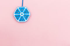 Electrical power strip color blue hexagon model on pink backgrou Royalty Free Stock Photography