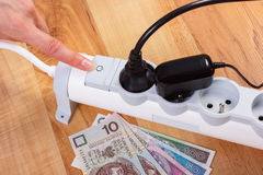 Electrical power strip with connected plug and polish currency money, energy costs Stock Photography