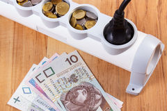 Electrical power strip with connected plug and polish currency money, energy costs Royalty Free Stock Photo
