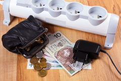 Electrical power strip with disconnected plug and polish currency money, energy costs Royalty Free Stock Image