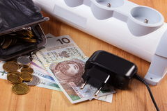 Electrical power strip with disconnected plug and polish currency money, energy costs Stock Photo