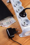 Electrical power strip with plugs and polish currency money, energy costs Stock Photo