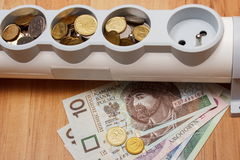 Electrical power strip and polish currency, energy costs Stock Photo