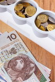 Electrical power strip and polish currency, energy costs Stock Photos