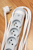 Electrical power strip with switch on-off on wooden floor Stock Photo