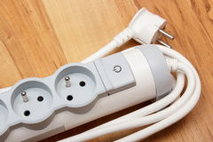 Electrical power strip with switch on-off on wooden floor Royalty Free Stock Photos