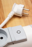 Electrical power strip with switch on-off on wooden floor. Electrical extension, power board Stock Image