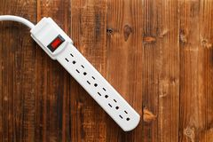 Power Strip. Electrical power strip on wood. Top down view royalty free stock photo