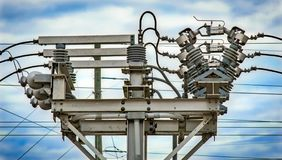 Electrical power sub station. Power is generated and pumped all over the world and this is only one very small sub station that is feeding high voltage stock photo
