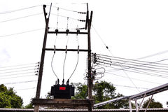 Electrical power transformer on high pole Royalty Free Stock Photo