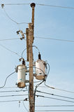 Electrical power transformer on pole. Close up of an electrical power transformer on pole Stock Photography
