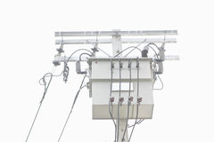 Electrical power transformer on pole isolated Stock Photo
