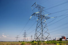 Electrical powerlines. Electrical power lines and nuclear power station under clear blue sky Stock Images