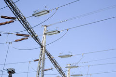 Electrical powerlines with men Royalty Free Stock Image