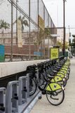 Electrical public bikes for rent Los Angeles California. Los Angeles, CA, USA - April 5, 2018: Row of public electrical bikes for rent in Chinatown, put out by royalty free stock images