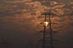 Electrical pylon and high voltage power lines near transformation station at Sunrise in Gurgaon Stock Image