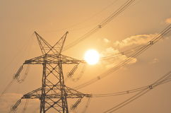 Electrical pylon and high voltage power lines near transformation station at Sunrise in Gurgaon Royalty Free Stock Image
