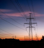 Electrical pylon and high voltage power lines at night. Stock Photography