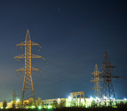 Electrical pylon and high voltage power lines at night. Royalty Free Stock Photos