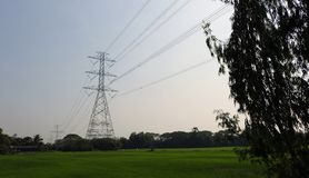 Electrical pylon and high voltage power lines at night. Electricity towers Stock Photography