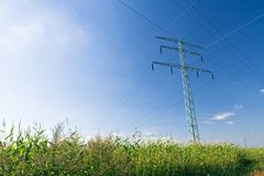 Electrical pylon over blue sky Stock Photography