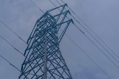 Electrical pylon tower and cables royalty free stock photography